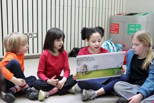Children looking at a book together